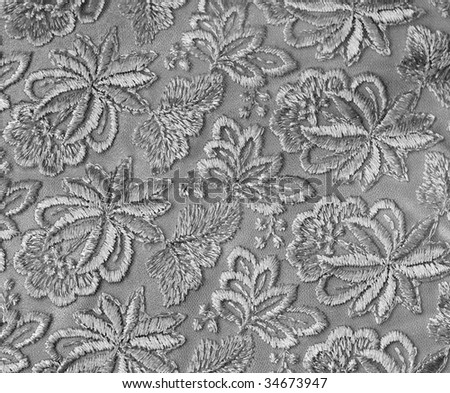 Silver guipure, embroidery on cloth for wedding dress, texture - stock photo