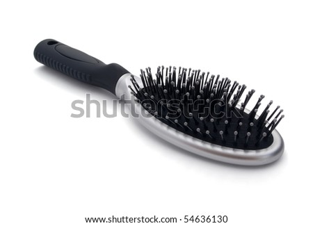Silver hair brush isolated on white - stock photo