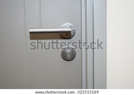 silver handle on gray door
