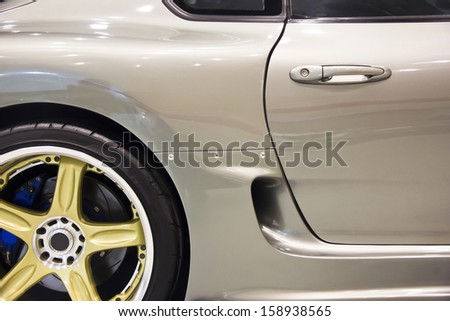 Silver handle on the door of sports car - stock photo