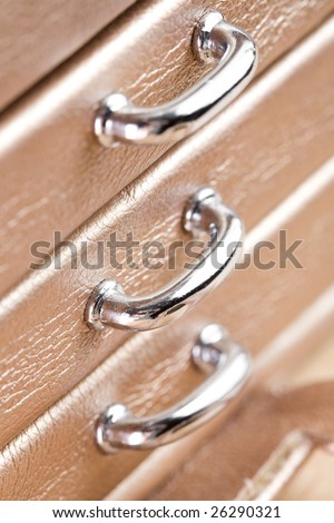 Silver handles of small casket. - stock photo