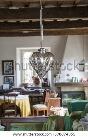 silver heart hanging with blurry background atmosphere of the house,the house symbol of unity, love and family