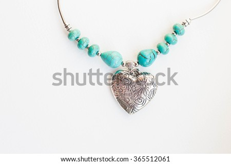 Silver heart with turquoise beads - stock photo