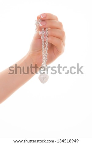 Silver jewelery in hand - stock photo