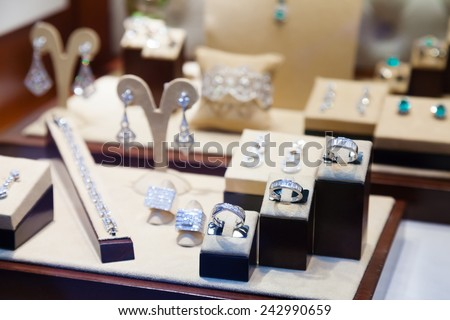 silver jewelry at showcase of store  - stock photo