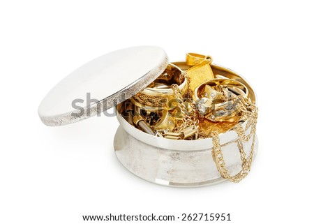 silver jewelry box with a variety of jewelry isolated on white - stock photo