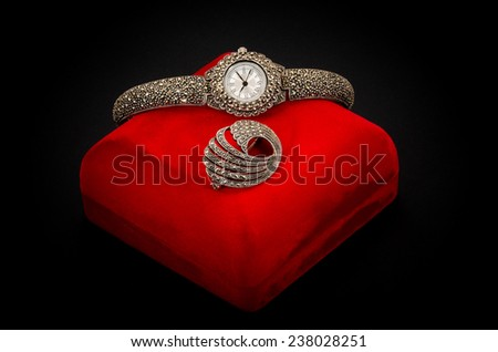 silver jewelry wristwatch on textured black background - stock photo