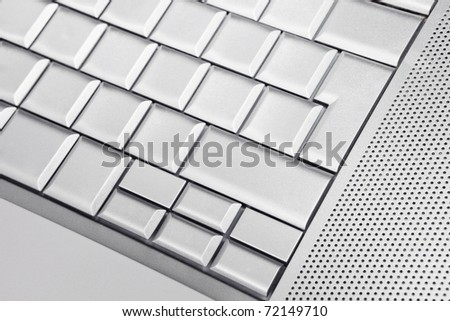 Silver keyboard detail with empty buttons. - stock photo