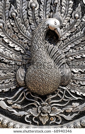 Silver lacquer Show Animals in mythology fine-art. Global Crafts Thai artists. Place in Chiang Mai, Thailand. - stock photo