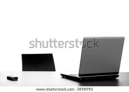 silver laptop with mouse on a office desk