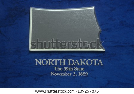Silver map of North Dakota - stock photo