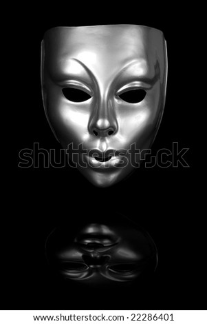 Silver mask isolated on black background - stock photo