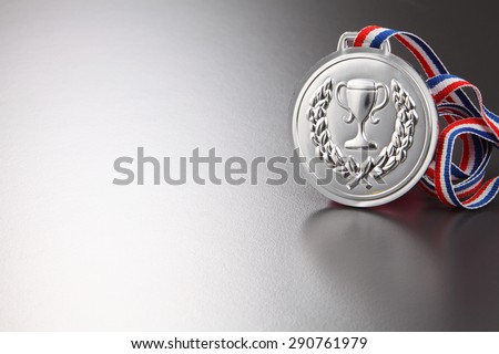 silver medal on the gray background - stock photo