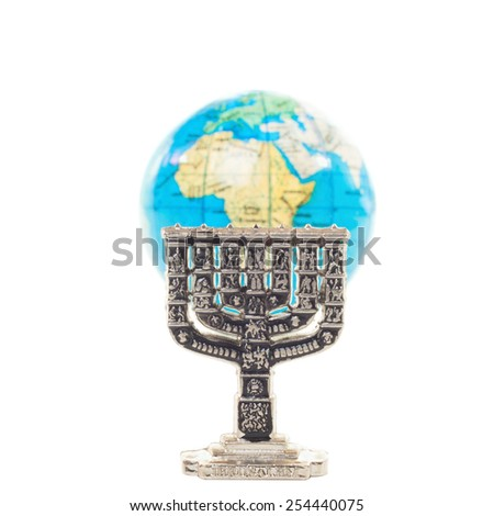 Silver Menorah and globe in shallow DOF isolated on white background - stock photo