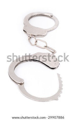Silver metal handcuffs on white background.