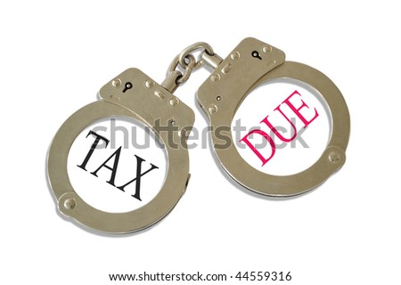 Silver metal handcuffs tax due concept - stock photo