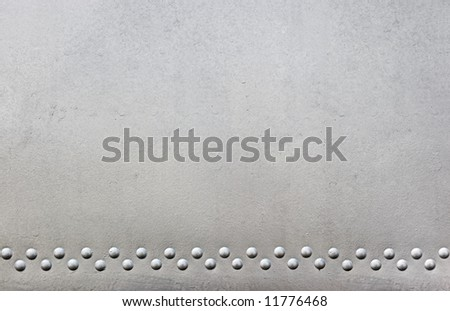 silver metal with rivets - stock photo