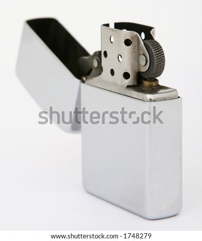 Silver metal zippo lighter for cigarettes, close up, macro, copy space, isolated on white - stock photo