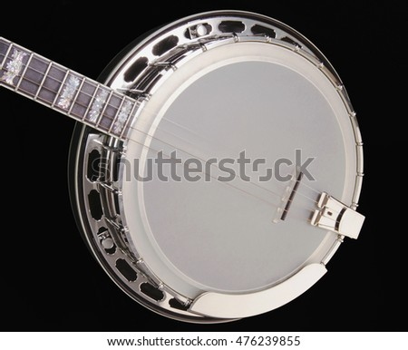 Silver metallic Banjo on black background. Music concept.
