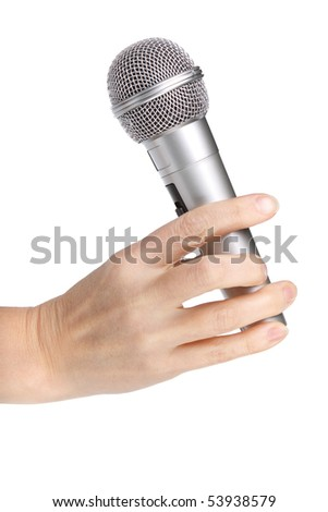 Silver microphone in a female hand on a white background.