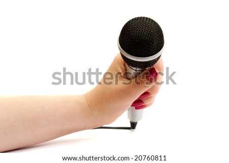 Silver microphone in female hand isolated over white background