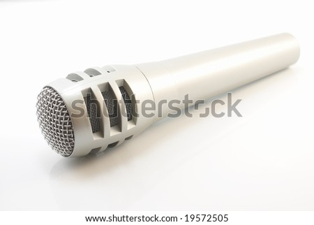 Silver microphone on a white background - stock photo