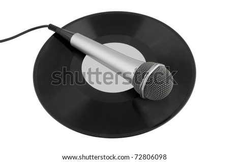 Silver microphone over a vinyl record isolated - stock photo