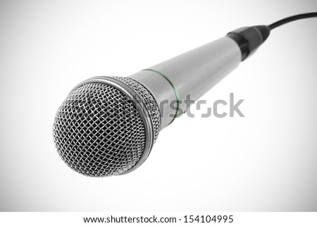 Silver microphone with black wire isolated on white - stock photo