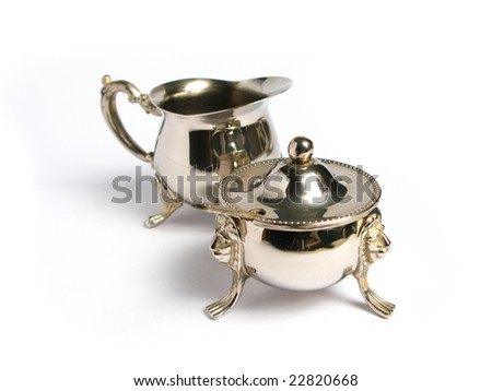 Silver Milk cup and sugar basin on a white background - stock photo