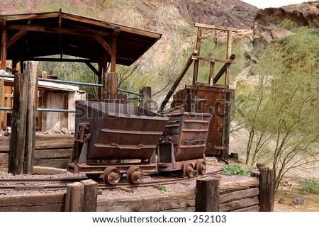 Silver mine and ore cars circa 1890's in the Silver boomtown of Calico California - stock photo