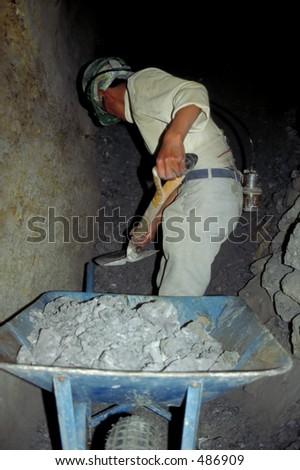 Silver Mine Worker in Potosi, Bolivia - stock photo