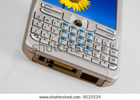 Silver mobile phone with a colorful picture on the display. - stock photo