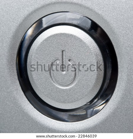 Silver modern computer power button. Close up. - stock photo