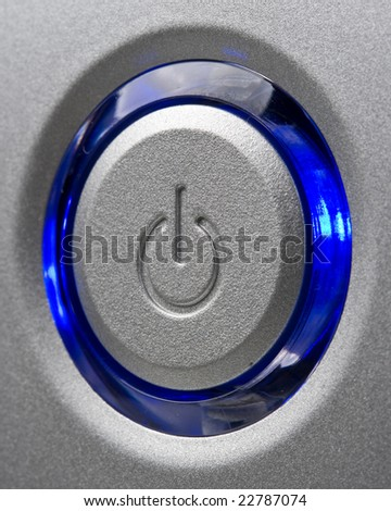 Silver modern computer power button with blue led. Close up. - stock photo