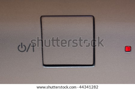 Silver modern power button. Closeup. - stock photo
