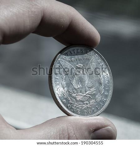 Silver morgan dollar - stock photo