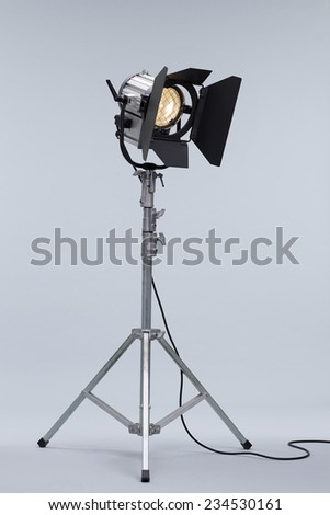 Silver Movie Studio Light on a Metal Stand isolated on Grey Background - stock photo