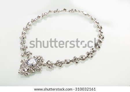 Silver necklace isolated on the white  - stock photo
