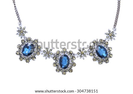 Silver necklace with blue stones isolated on whit - stock photo