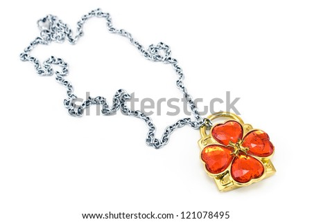 Silver necklace with clover pendant and red gems isolated on white - stock photo