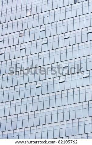 Silver office building glass wall - stock photo