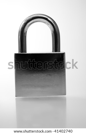 Silver padlock over white with reflection - stock photo