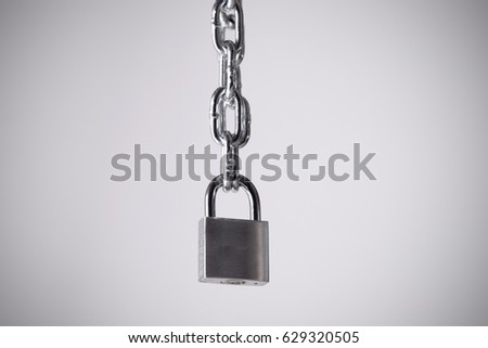silver padlock with key and chain