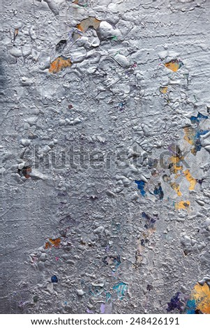 Silver paint peeling off old concrete wall