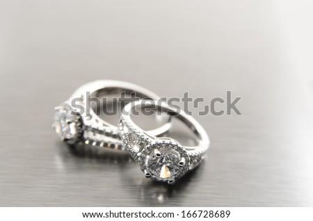 silver pair of diamond rings close up - stock photo