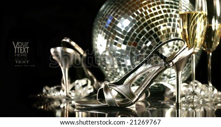 Silver party shoes with champagne glasses against a party background - stock photo