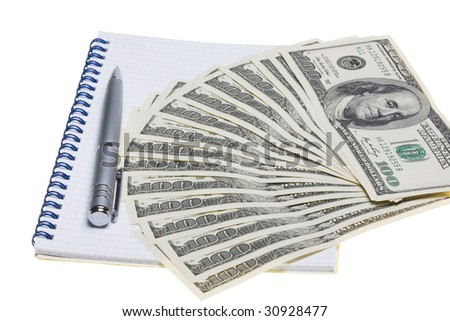 silver pen on the background of the dollar banknotes
