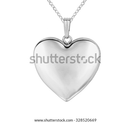 Silver pendant in shape of heart on chain isolated on white - stock photo