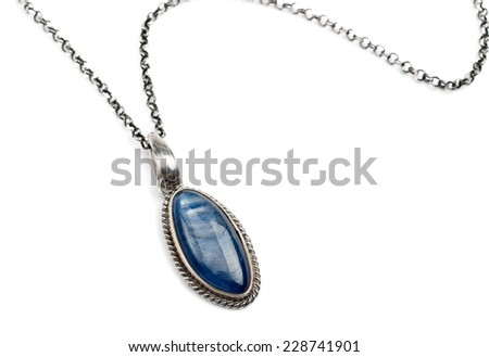 Silver pendant with blue gem stone - stock photo