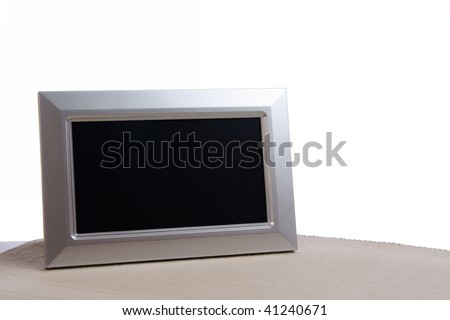 silver photo frame on the table in white background - stock photo